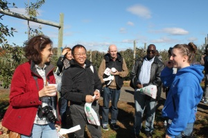 Shannon, a guide at Alstede Farms in Chester, New Jersey, shows Fulbright scholars and students the apple orchards