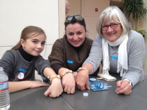 Fulbright family members proudly display their handmade jewelry.