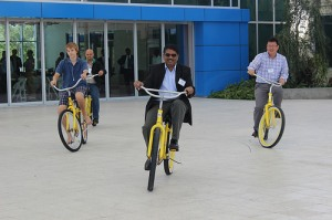 Scholars bike across the Eckerd College campus.