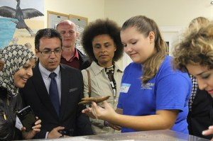 A student shows Scholars a star fish at the Cousteau Center.