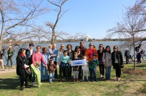 Scholars and CIES staff pose in front of the Tidal Basin after the Ceremonial Lighting of the Japanese Stone Lantern