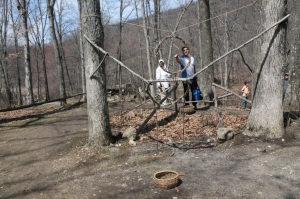 Scholar Khaled Taktek from Canada tries Lenape-style target practice.