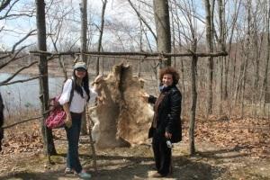 Scholars, Bin Jin from China La Lashvili from Georgia touch a deer pelt.