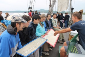 Fulbright scholars learning how the Sloop's crew navigates along the Hudson River