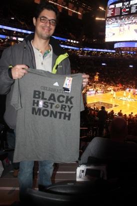 Brazillan scholar, Amilcar Pereira displaying his newly acquired Black History Month Brooklyn Brooklyn Nets shirt.